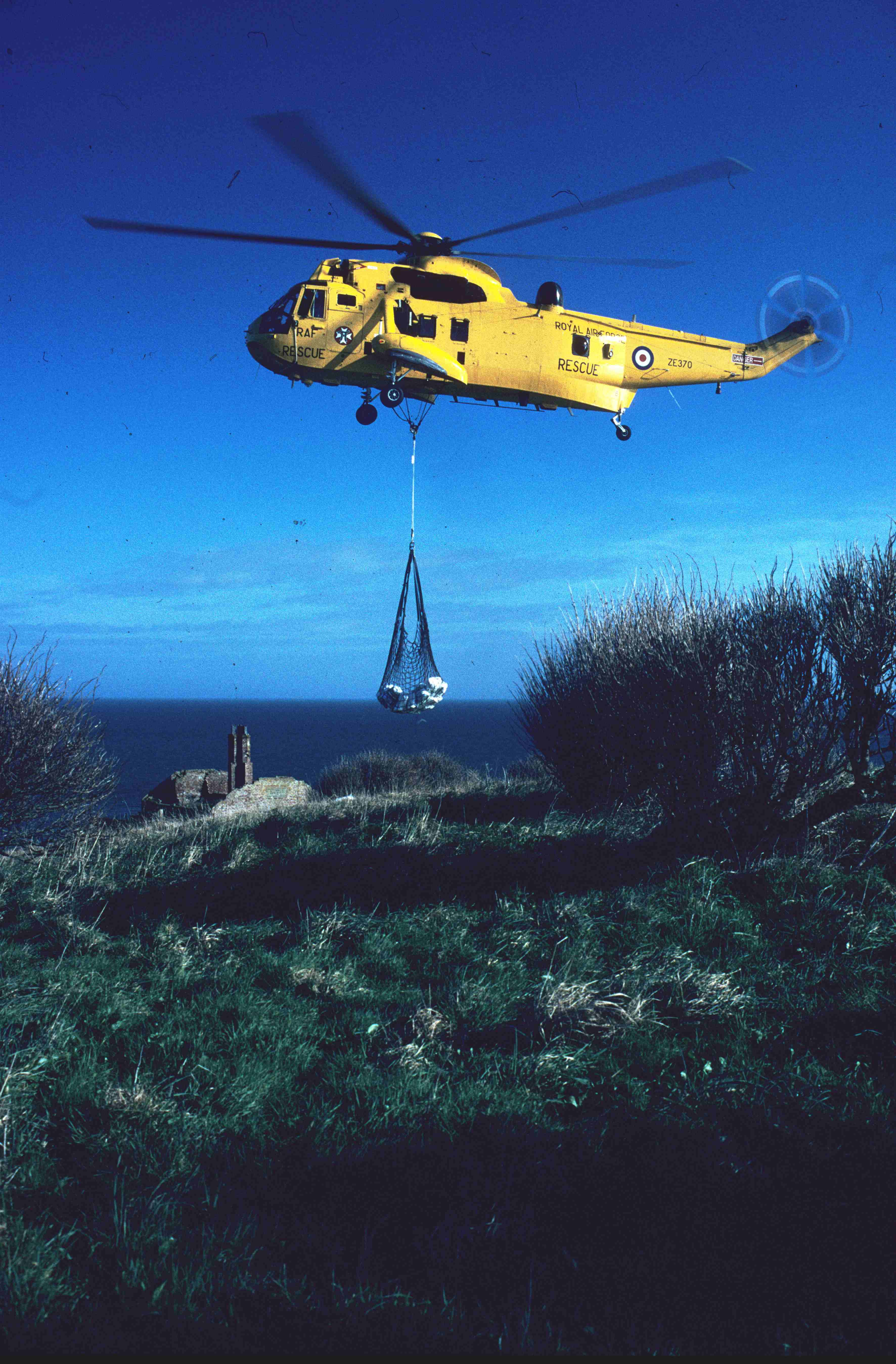 Helicopter delivery of second tonne of bait. Copyright: J B Ratcliffe1998